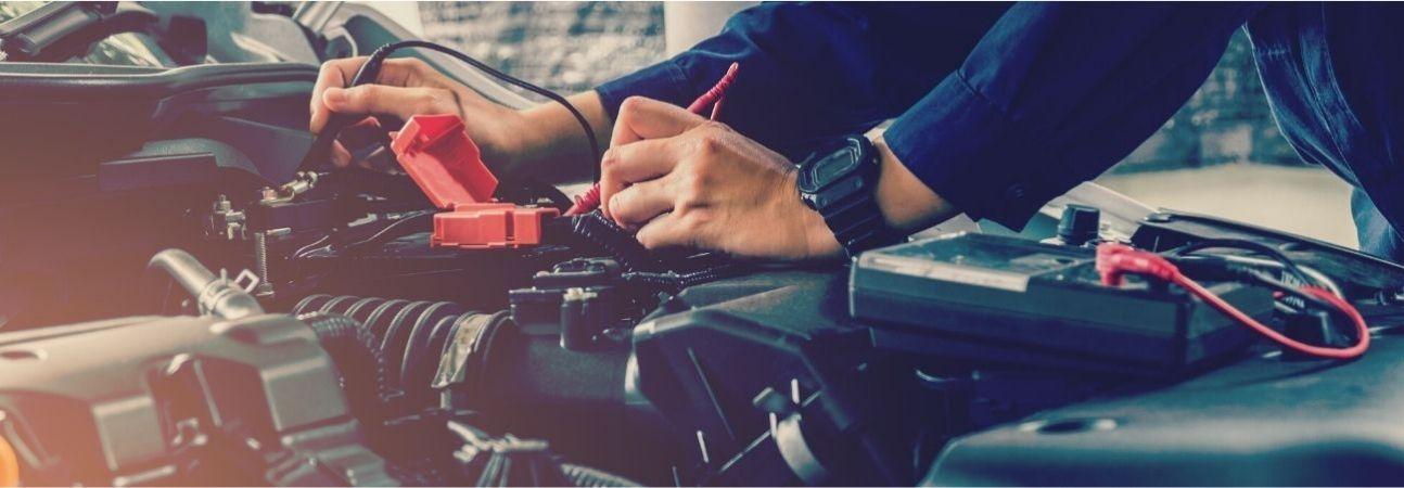 automotive expert working under a car